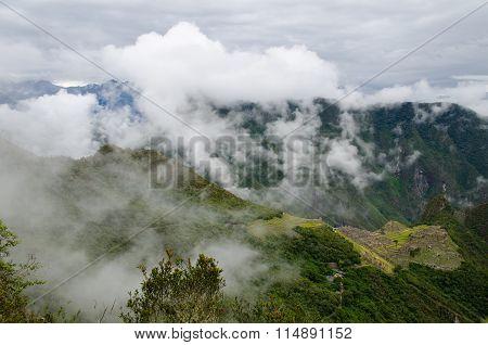 View from the Inca Trail over the Inca ruins of Machu Picchu Peru