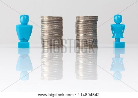 Equal Pay Concept Shown With Figurines And Coins