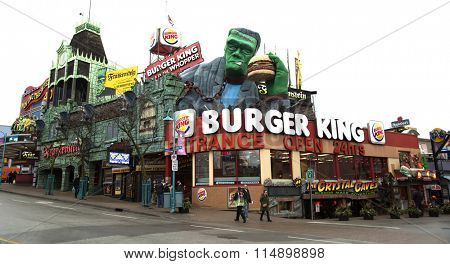 NIAGARA FALLS, CANADA-JANUARY 11, 2016:  Burger king restaurant in Niagara falls with Frankenstein eating a whopper burger on top.