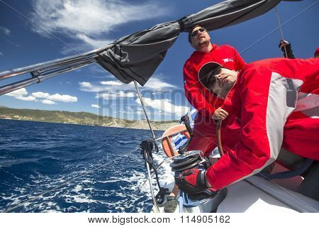POROS - ERMIONI, GREECE - CIRCA MAY, 2014: Sailors participate in sailing regatta 11th Ellada 2014 among Greek island group in the Aegean Sea, in Cyclades and Argo-Saronic Gulf.