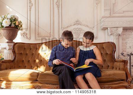 Happy kids reading book