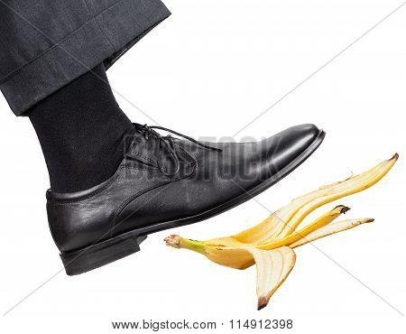Leg In The Right Black Shoe Slips On A Banana Peel