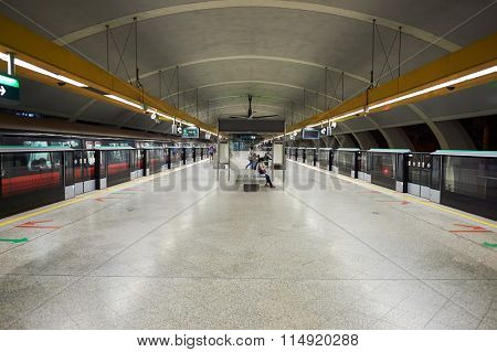 SINGAPORE - NOVEMBER 07, 2015: interior of MRT station. MRT, is a rapid transit system forming the major component of the railway system in Singapore, spanning the entire city-state