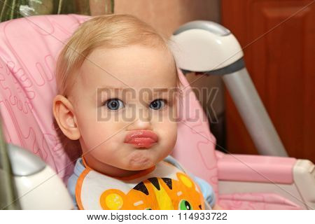 Portrait Of A Little Blond Child With Pouty Lips