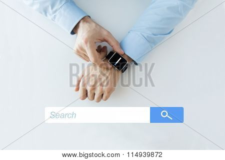 hands with internet browser search on smartwatch