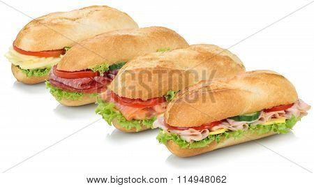 Collection Of Sub Sandwiches Baguettes With Salami, Salmon, Ham And Cheese Isolated