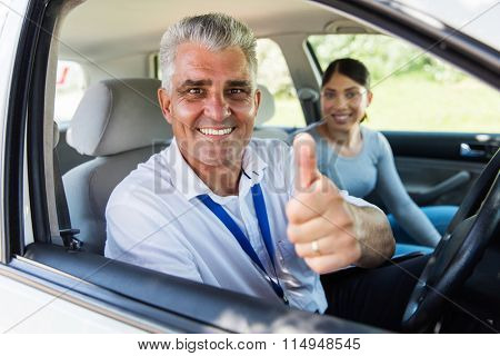 handsome senior driving instructor giving thumb up