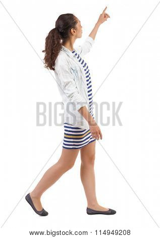 back view of walking  woman. beautiful girl pointing.  backside view of person.  Rear view people collection. Isolated over white background. Swarthy woman is pointing upwards.