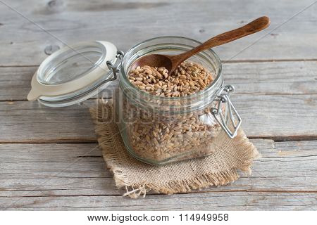 Raw Whole Spelt In A Glass Jar