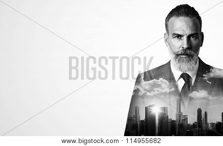 Close-up portrait of stylish businessman. Double exposure city on the background. Wide.
