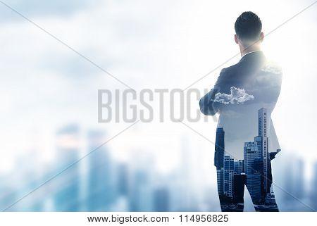Gentleman in moder suit looking on the city. Double exposure skyscraper background. Blurred effects.