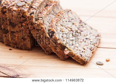 Wholemeal, wholewheat bread on wooden table. Organic, healthy food, breakfast.