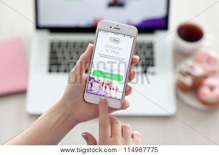 Woman Holding Iphone 6S Rose Gold With Viber On Screen