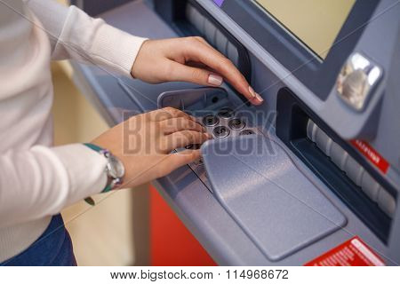 Female arms, ATM - entering pin