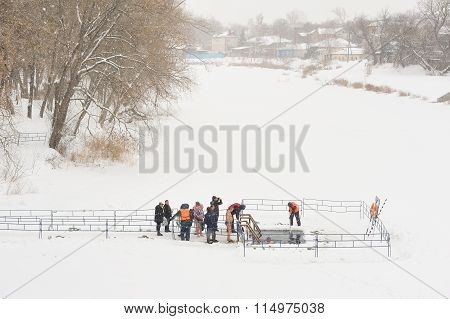 Orel, Russia - January 19, 2016: Russian Epiphany Feast. People Bathing In Ice-hole