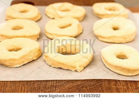Unbaked Donuts Of Dough With Flour