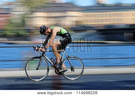 Rapid Cycling Man On Black Racing Bike, The Speed Makes It Un-sharp
