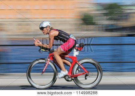 Rapid Cycling Woman On Advanced Red Racing Bike, The Speed Makes It Un-sharp