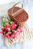 picnic basket full of pink tulips - food and drink poster