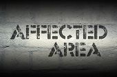 affected area stencil print on the grunge white brick wall poster