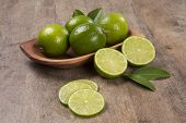 Fresh citrus lime with mint close up on wooden background. Fresh fruits. poster