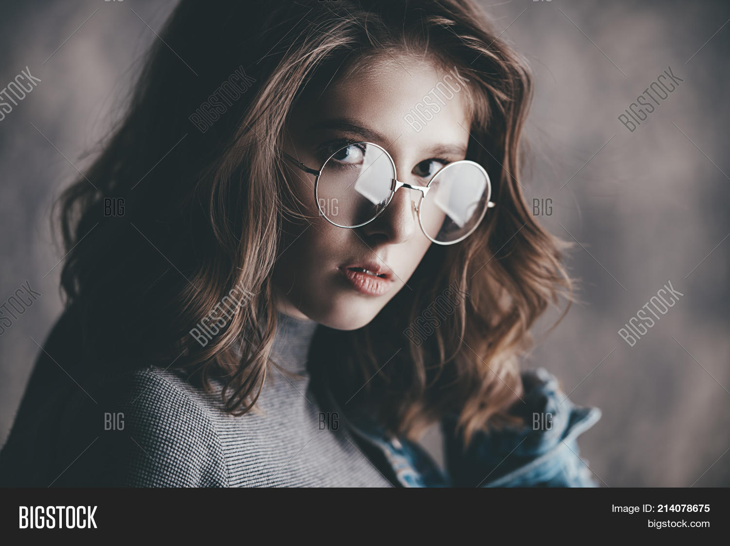 27a94abd62 Portrait of a cute girl teenager wearing spectacles. Glasses for a modern  young generation.