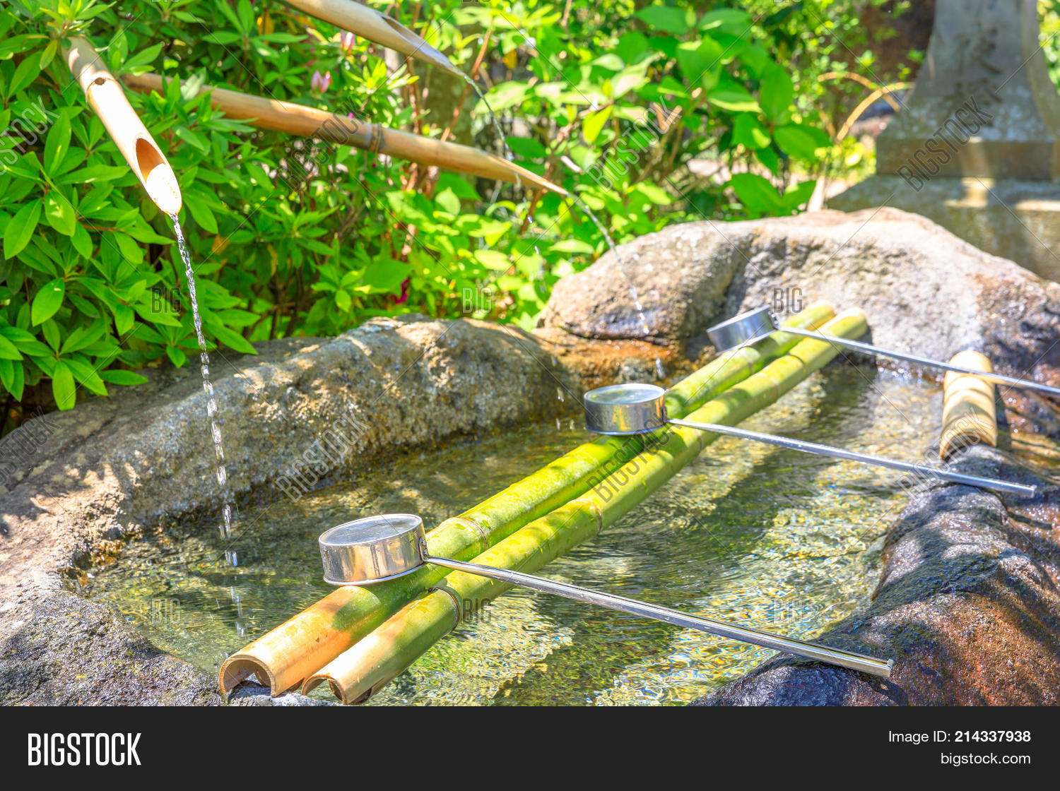 Close Up Of Japanese Bamboo Fountain And Ladles Used For Washing Hands Purification Fountain With