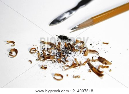 sharpened pencil and shavings isolated on white background