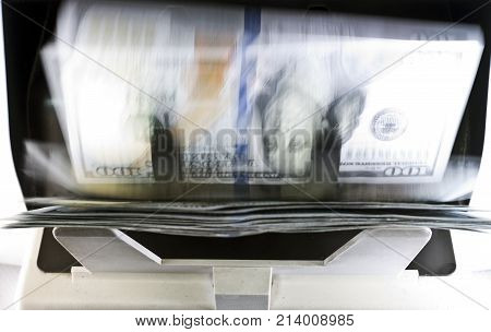 electronic money counter machine is counting is counting the American hundred-dollar (US dollars) banknotes blurry effect of the movement