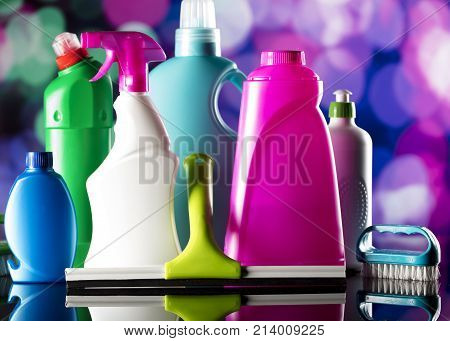 Holidays cleaning. Cleaning products on colorful bokeh background and glass table.