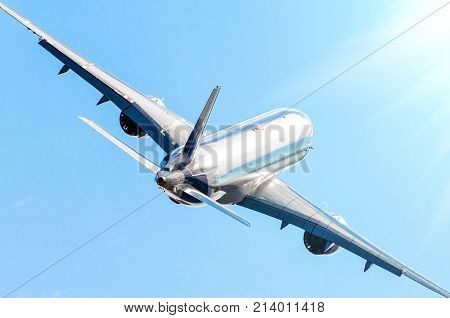 Passenger airplane shiny fuselage and climbing flight