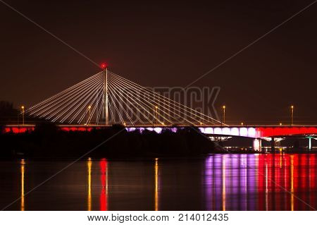 A cable-stayed bridge at night. Warsaw Poland