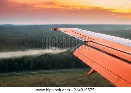 Minsk, Belarus. Twist Of Air On Wings Of Plane During Landing, Reduction Or Abrupt Maneuver Of Aircraft.