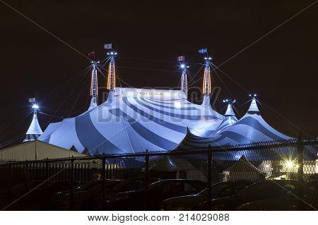 Toronto Canada - Oct 13 2017: Cirque du Soleil circus tent big top illuminated at night. Toronto Province of Ontario Canada