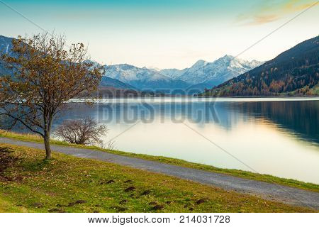 Lake Resia at sunset in the Italian eastern Alps