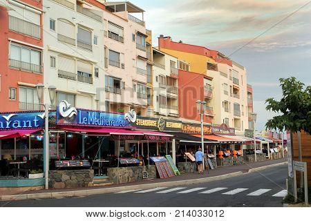 Cap D'agde, Herault, France - August 30 2017: Street Of Restaurants And Bars On A Warm Summer Evenin