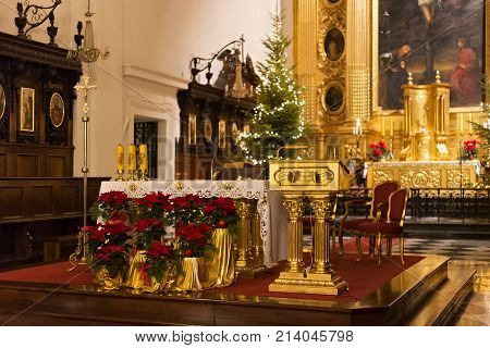 WARSAW, POLAND - JANUARY 02, 2016: Lectern in the Roman Catholic Church of the Holy Cross (XV-XVI cent.) in Christmas decorations. Is a one of the most notable Baroque churches in Poland's capital.
