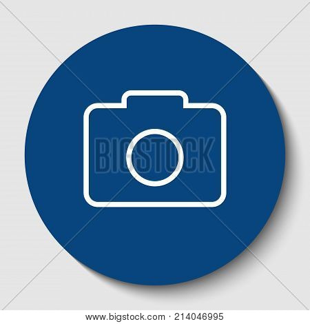 Digital camera sign. Vector. White contour icon in dark cerulean circle at white background. Isolated.