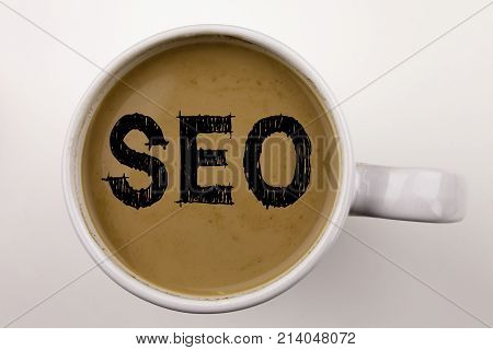 Seo Search Engine Optimization Writing Text In Coffee In Cup. Business Concept For Seo On White Back