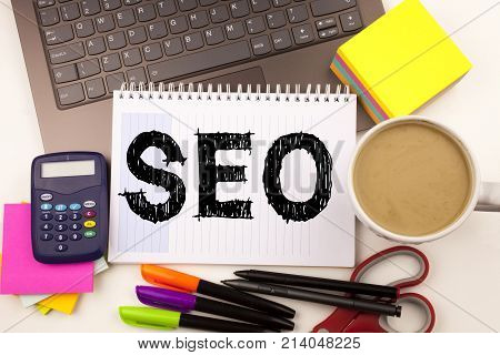 Seo Search Engine Optimization Text In The Office With Surroundings Such As Laptop, Marker, Pen, Sta