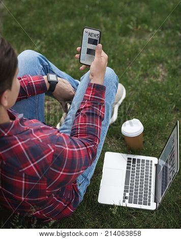 Man Reading New On Smartphone