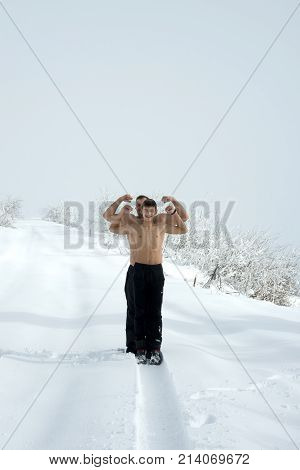 Father And Son In Mountain Snow Landscape