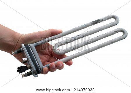 Hand holding washing machine heater isolated on a white background