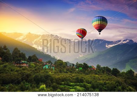 Hot balloon air fying over Manali town in India.