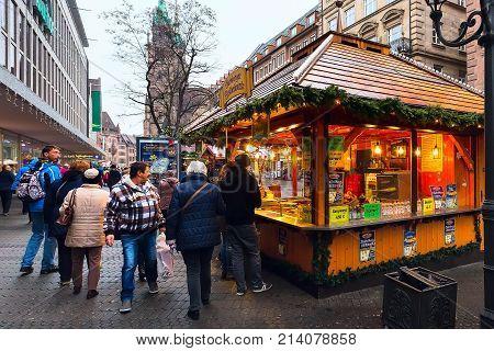 Nuremberg, Germany - December 24, 2016: Christmas market with kiosks and stalls, people in Nuremberg Bavaria