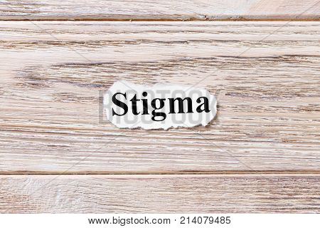 Stigma of the word on paper. concept. Words of Stigma on a wooden background.