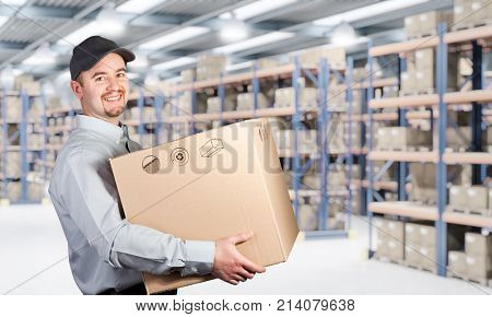 delivery man hold box in warehouse