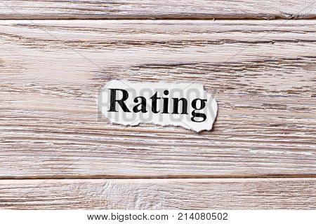 RATING of the word on paper. concept. Words of RATING on a wooden background.