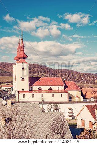 Roman catholic church in Divin village Slovak republic. Religious architecture. Cultural heritage. Red photo filter.