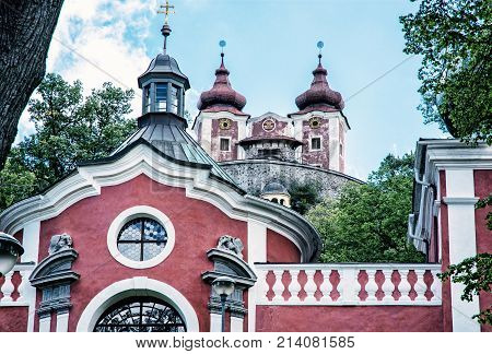 Calvary in old mining town Banska Stiavnica Slovak republic. Religious architecture. Travel destination. Blue photo filter.